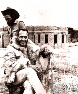 Jean Michel  and Franklin in front of JM's adobe